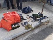 Polícia encontrou dinheiro e armas em caminhão de lixo