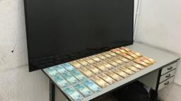 PM acha R$ 38 mil com homem procurado da Justiça por furto