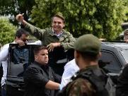Escoltado pela PF, Bolsonaro diz que expectativa é de vitória